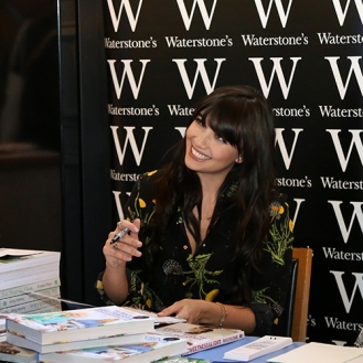 Model Daisy Lowe signing her book 'Sweetness and light'